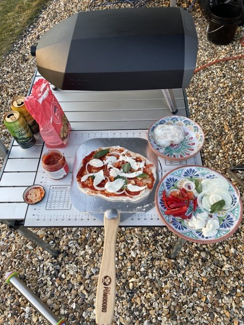 Cooking pizza outside in a mini pizza oven