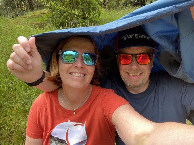 Katie & Jason sheltering from the rain